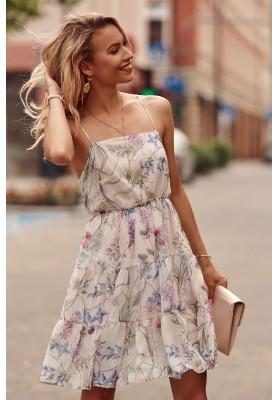 Jemné šaty s rôznymi vzormi a s rovným výstrihom, krémové