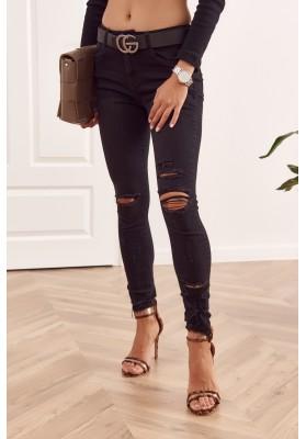 Trendy čierne riflové džínsy s rozparkami a dierkami