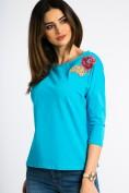 Nádherný, modrý top s nášivkou kvetu.
