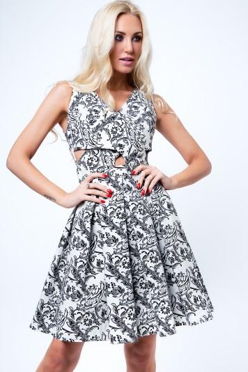Čierno-krémové dámske šaty s motívom