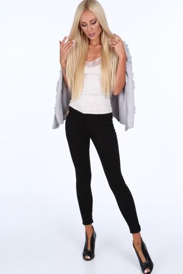 Čierne dámske džínsy s perlami na spodku nohavice